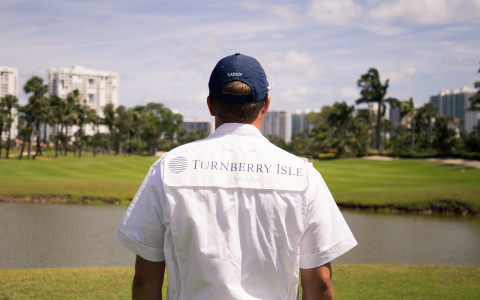 back of a man looking onto golf course