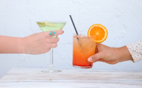 two women holding their cocktails