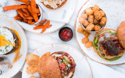 burgers, tater tots, and sweet potato fries