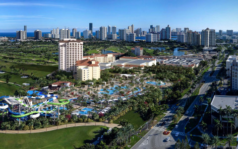 aerial view of resort and water park in aventura