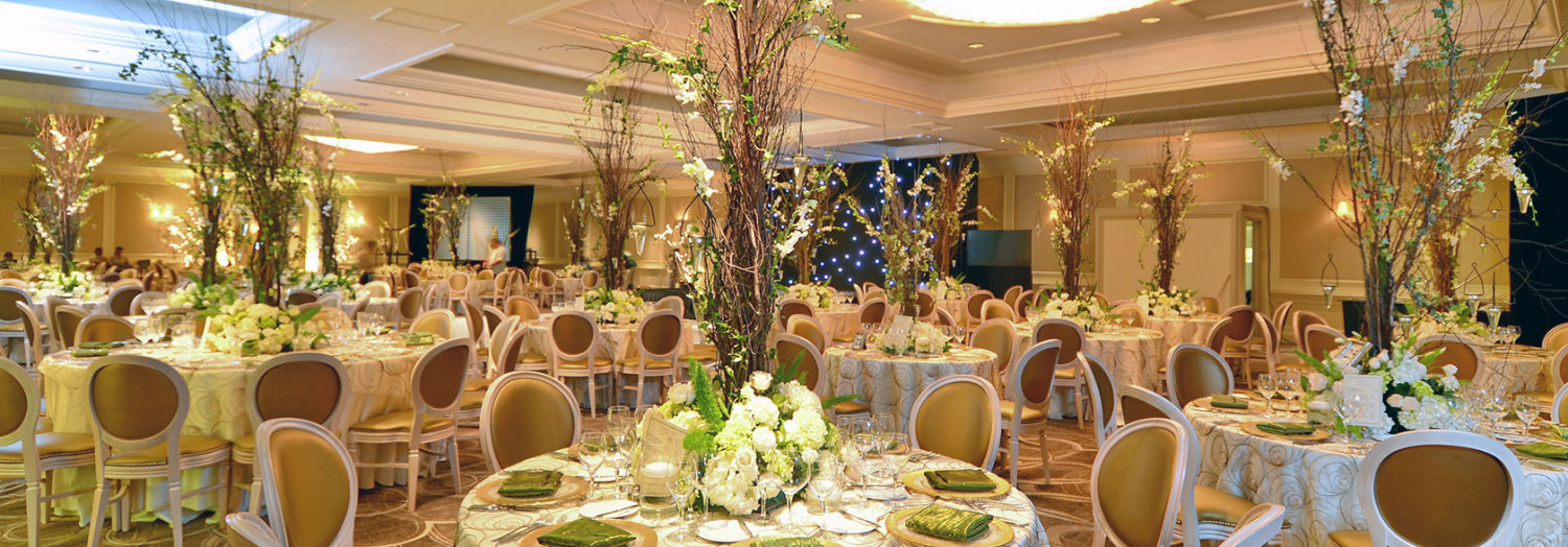 tall center pieces on tables at wedding reception