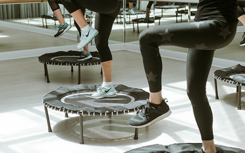 Close up of women stepping onto mini trampolines