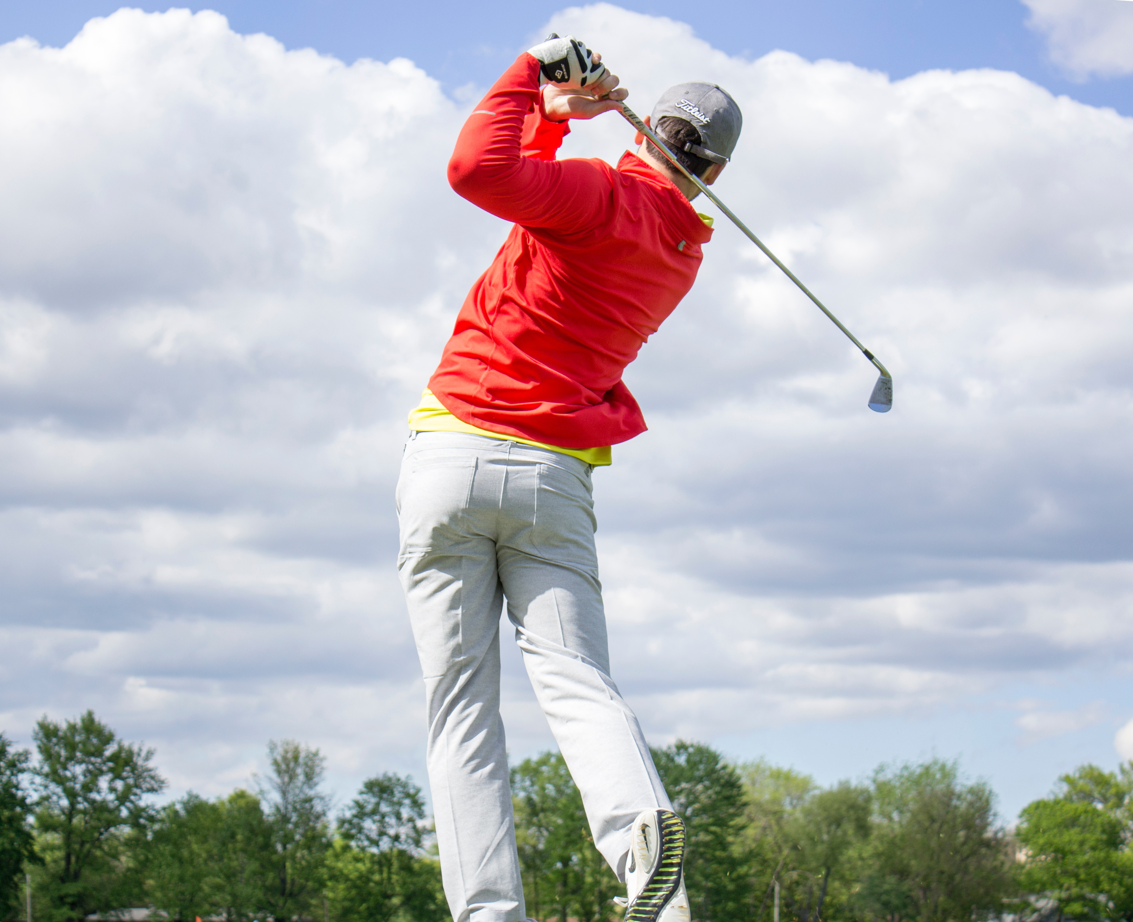 man at final moment of golf swing