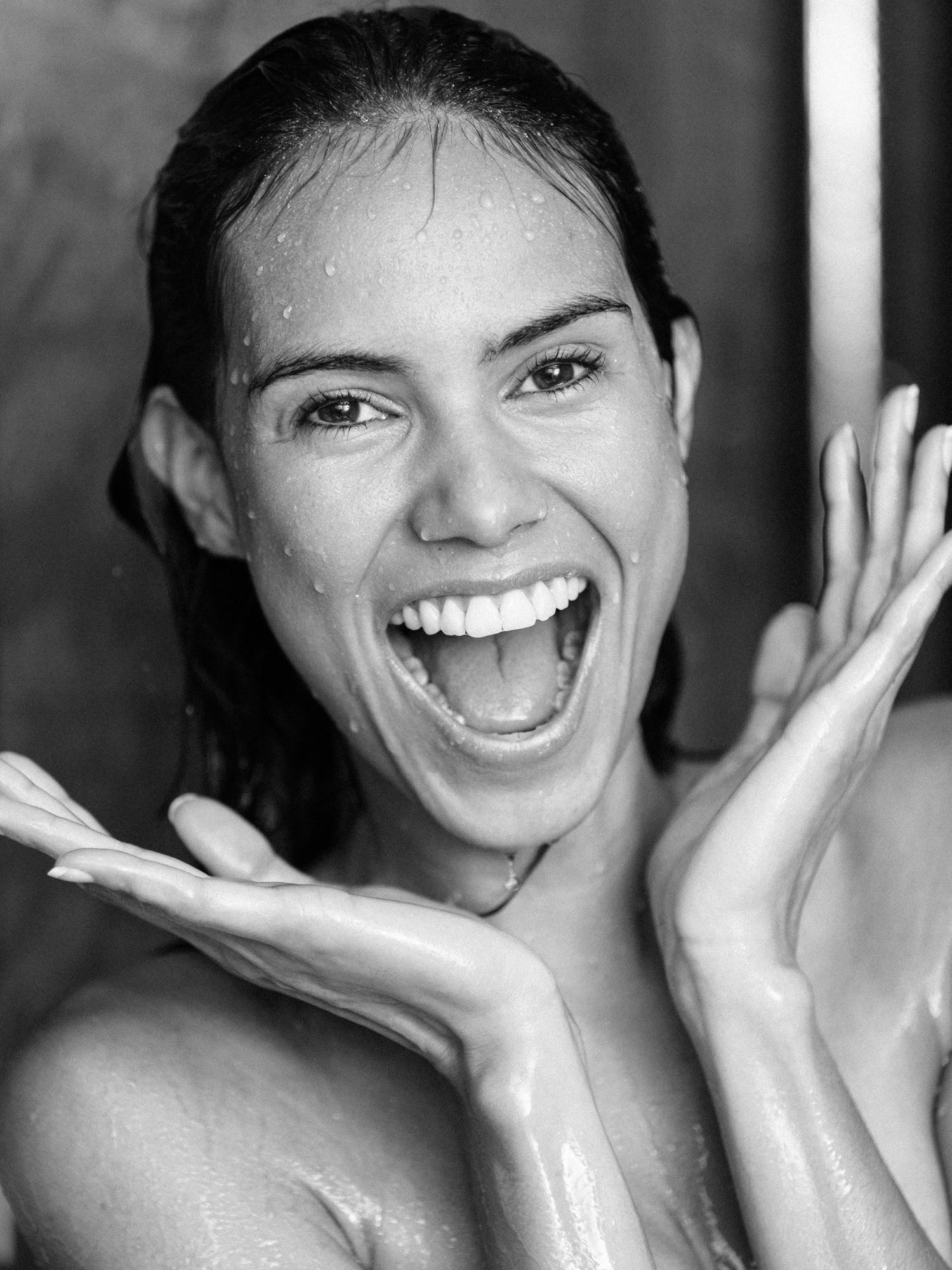 woman smiling in shower