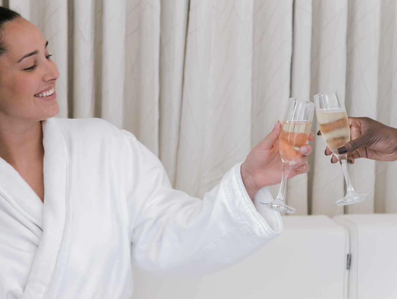women toasting champagne at turnberry spa