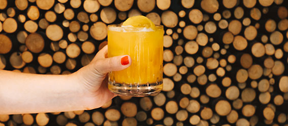 Orange drink with wood
