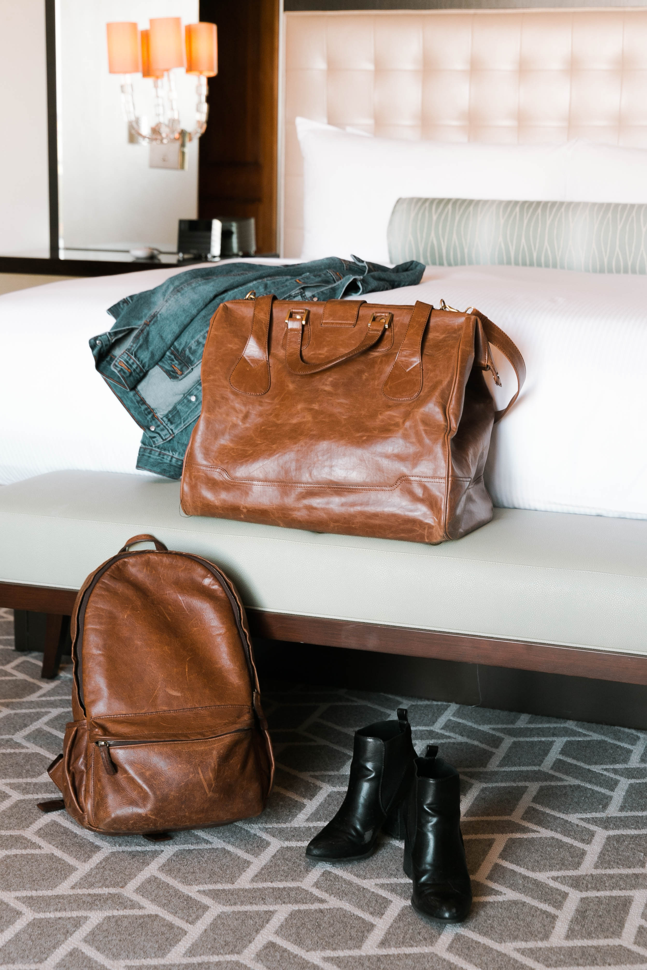 Luggage and jacket on the bed