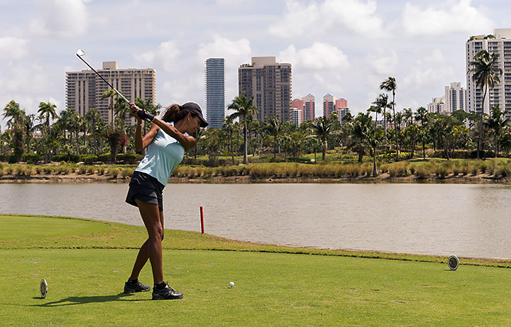 Woman playing golf 1