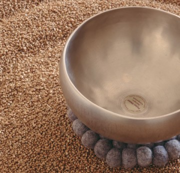 Sand and brass bowl