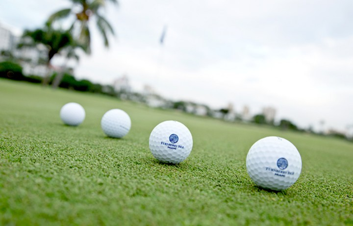 Golf balls lined up at Turnberry Country Club
