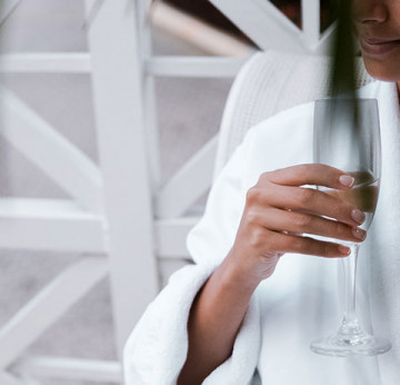 Women with glass of champagne at Ame Spa Miami