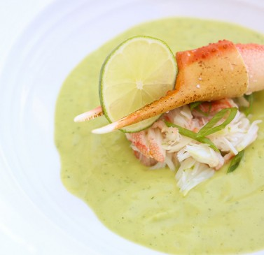 White dish with lobster in green sauce