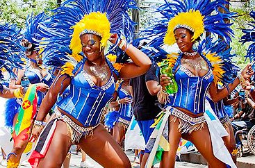 Two women in costume with elaborate headpieces at the Atlanta Caribbean Carnival