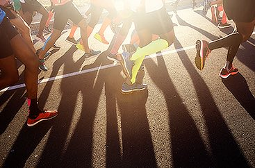 Close up of people's legs running at the Thanksgiving Day Half Marathon