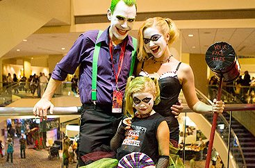 A man, woman, and child dressed as characters at Dragon Con event