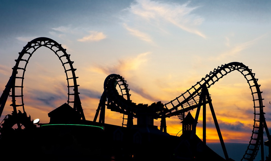 Roller coaster ride at sunset