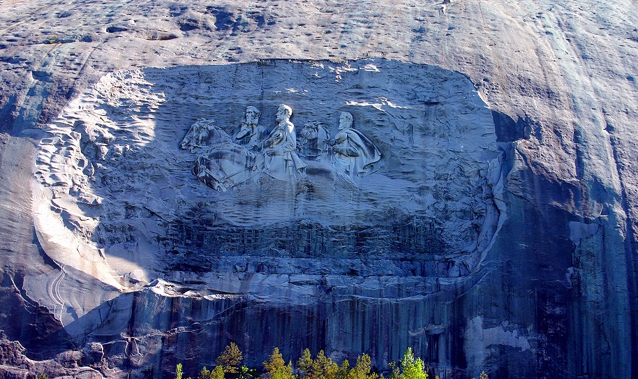 A carving of men riding horses in Stone Mountain