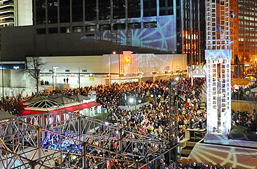 Peachtree Center with a crowd of people outside at night