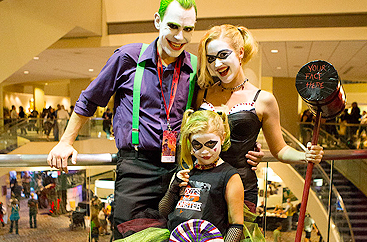 A man, woman, and child dressed in costume at Dragon Con event