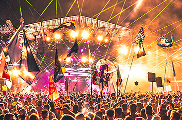 Crowd of people at a concert for Imagine Festival with colorful lights everywhere