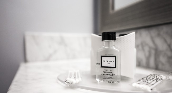 bathroom amenities on a marble countertop