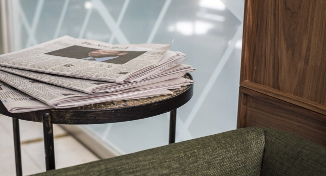 newspapers on a table in the lobby