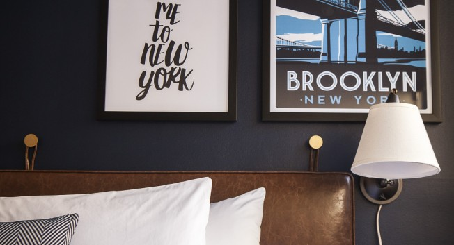 bed and decorative new york themed posters