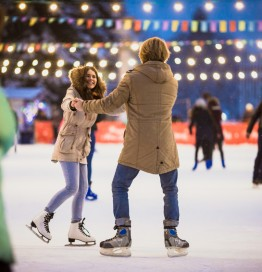 couple skating in outdoor rink