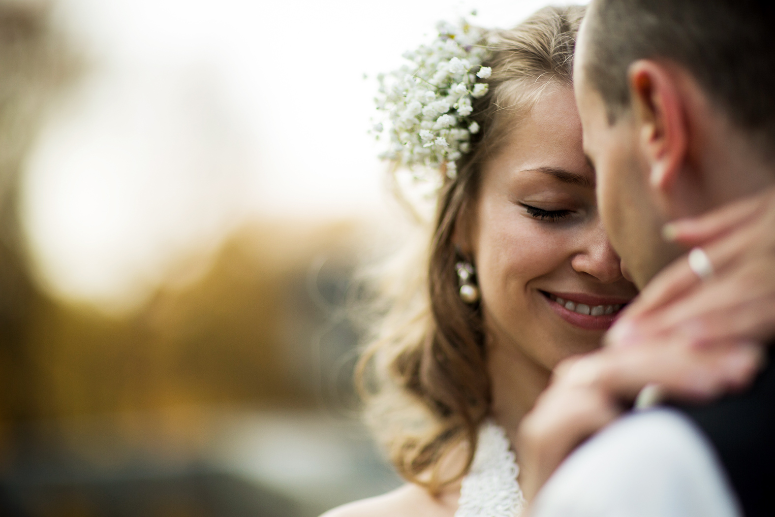Bride & groom touching foreheads