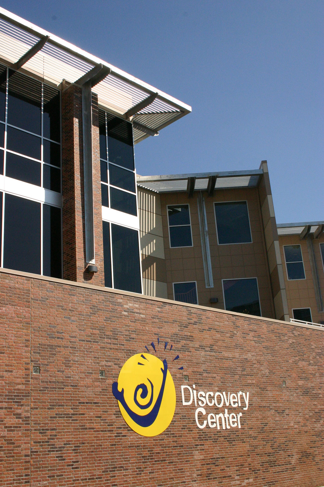 Discovery Center logo on brick wall