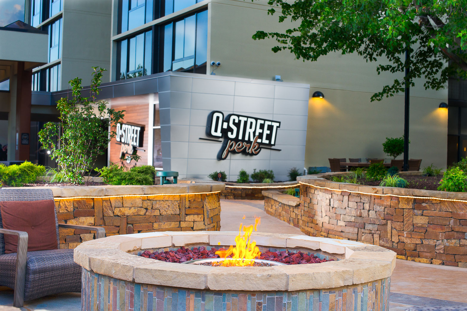 Q Street Perk entrance with fire pit