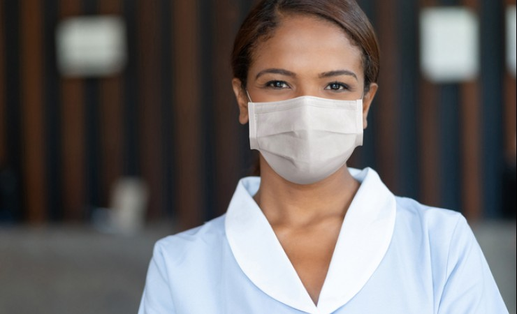female housekeeper with mask