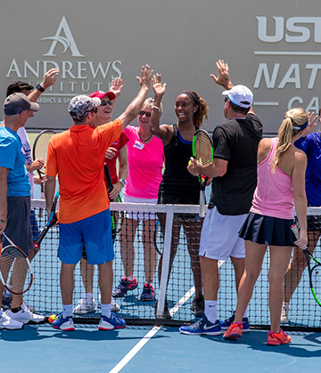 Group of tennis player high fiving