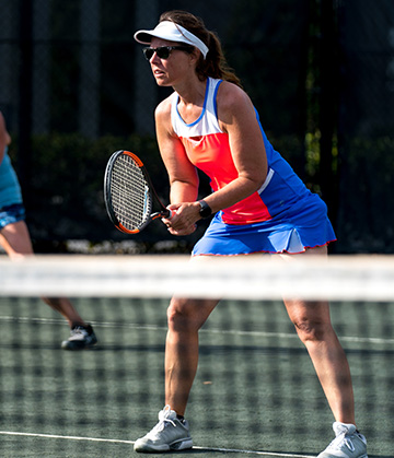 Woman holding racket ready to hit tennis ball