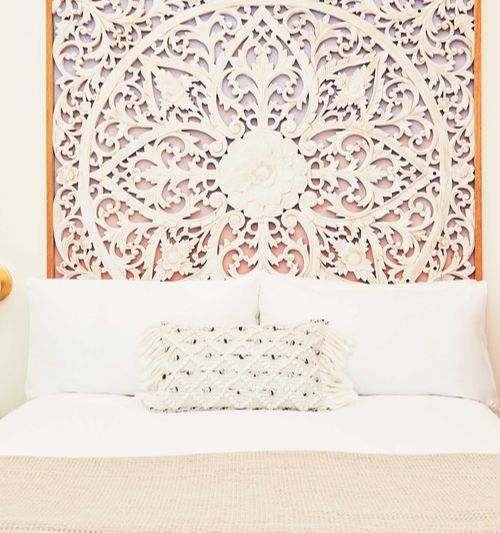 bed with wallpaper design