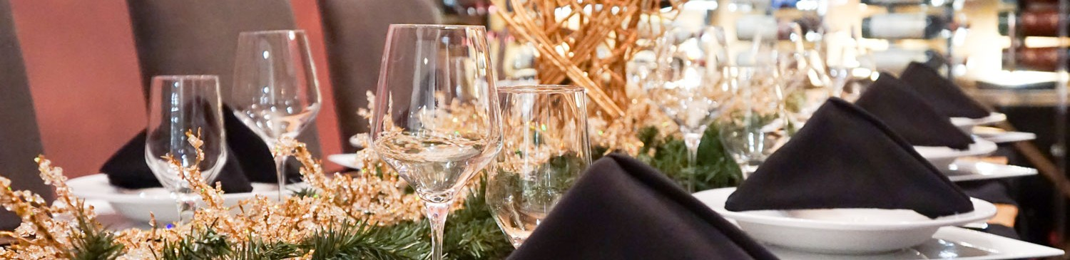 wine glasses in front of a whicker centerpiece