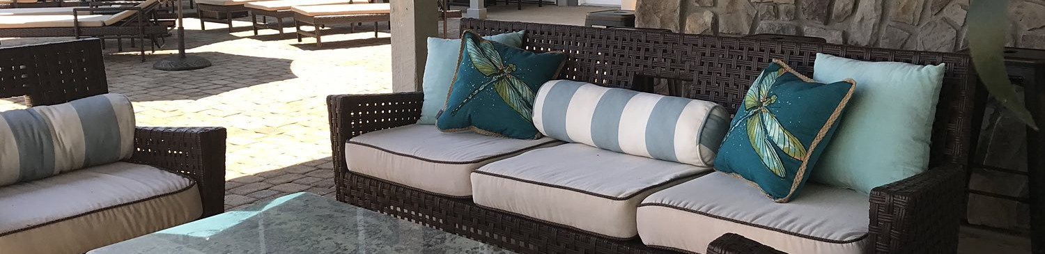 grey chairs on a patio with cushions