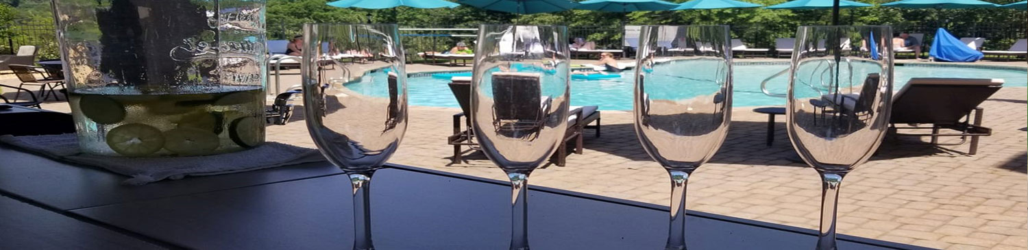 pool with 4 champagne glasses
