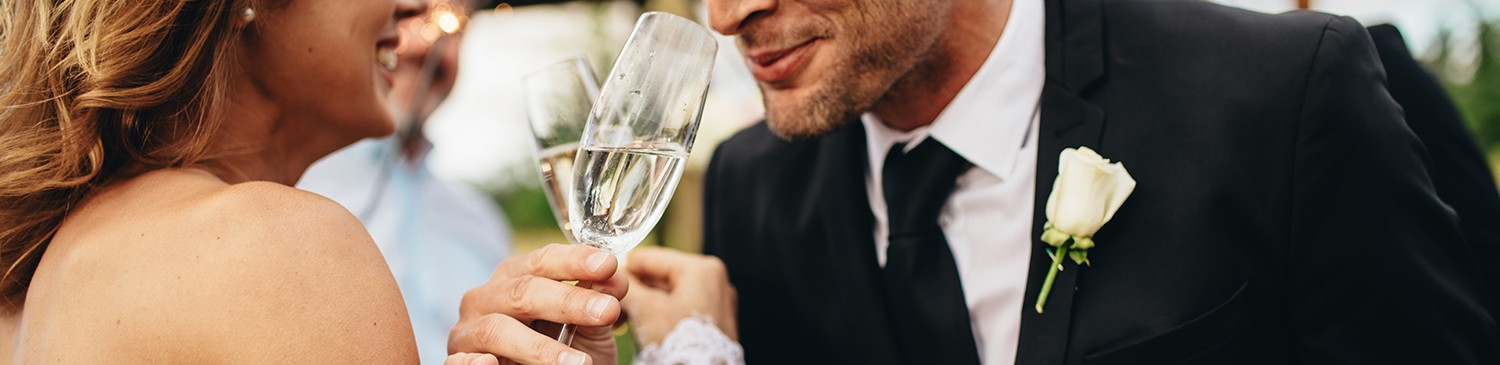 man drinking a glass of champagne