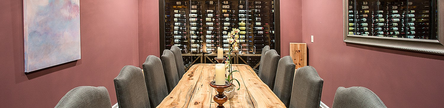wine cellar with bottles and a wooden table