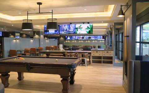 Billiard tables next to tvs
