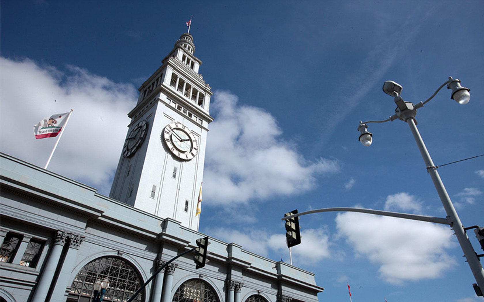clock tower at port of san francisco with california flag