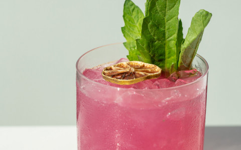 pink Vistal cocktail in rocks glass