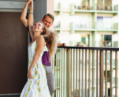 Couple dancing on balcony