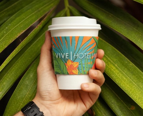hand holding a vive coffee cup