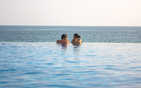 couple talking in the infinity pool