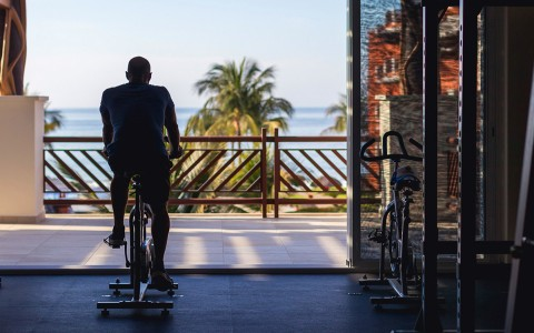 man working out with an ocean view