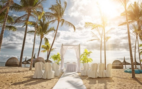 beachside wedding ceremony set up of the altar, chairs and runner