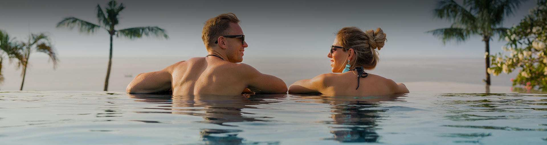 Couple taking a breath in the ocean view pool
