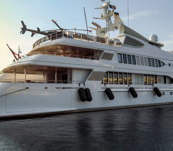 large superyacht docked in the waterway